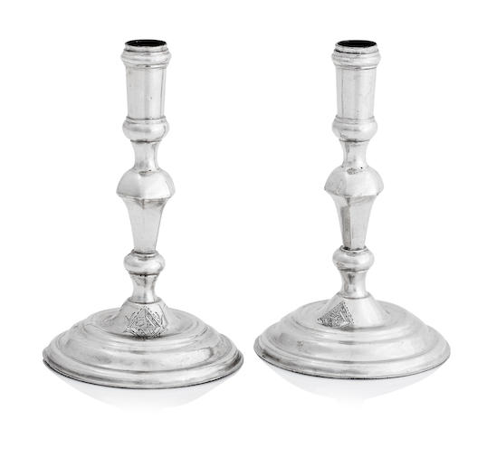 A pair of George I miniature silver candlesticks