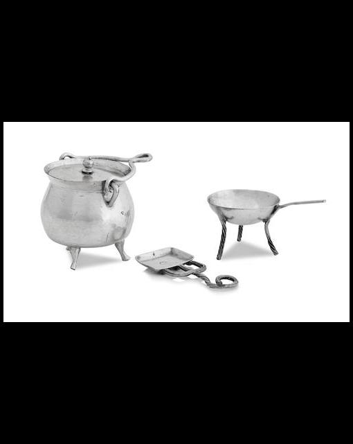 A miniature cauldron and cover