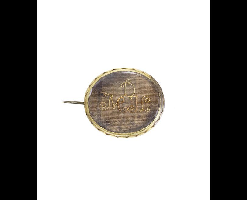 A Stuart crystal brooch and a slide