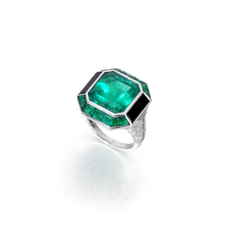 An emerald, diamond and onyx dress ring