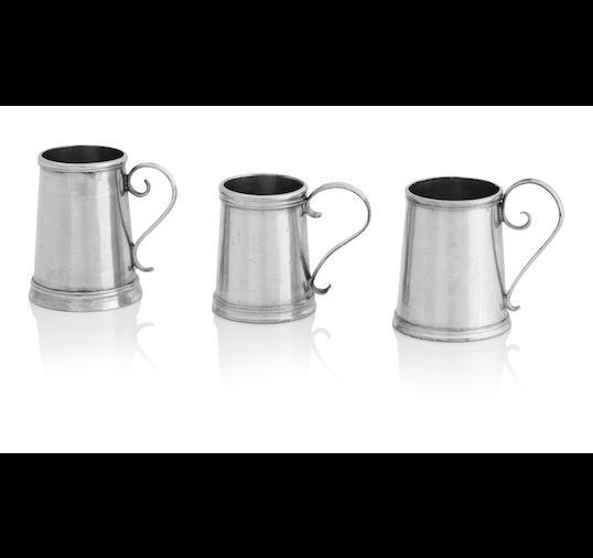 Three early 18th century miniature silver mugs