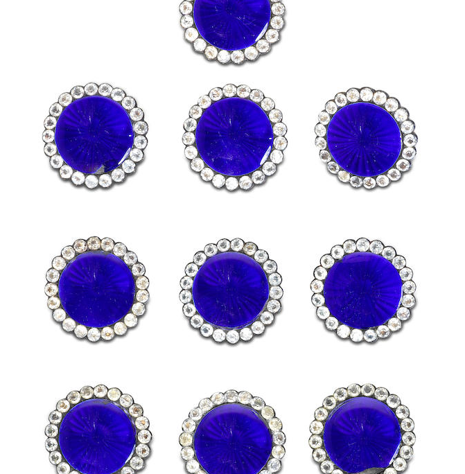 A set of nine large antique enamel and white paste buttons