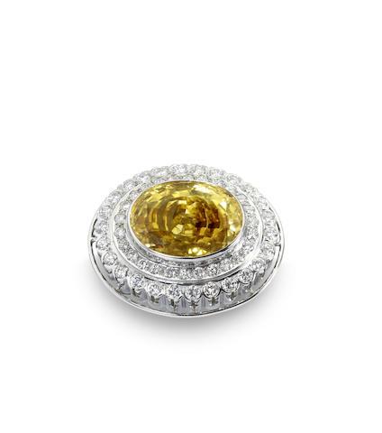 A yellow sapphire and diamond pendant