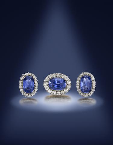 A sapphire and diamond cluster brooch and earring suite