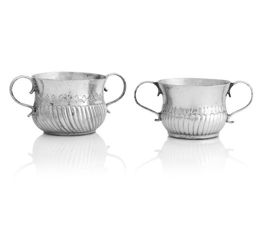 A Queen Anne and a George I miniature silver twin handled porringer