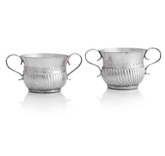 Two Queen Anne miniature silver twin handled porringers