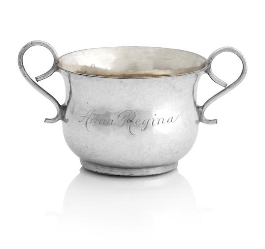 A Queen Anne miniature silver twin handled porringer