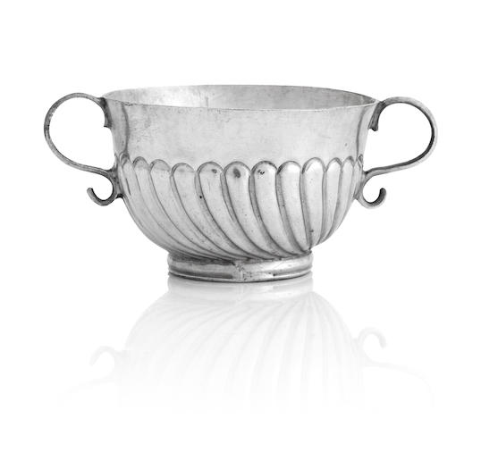 A late 17th century miniature silver twin handled porringer