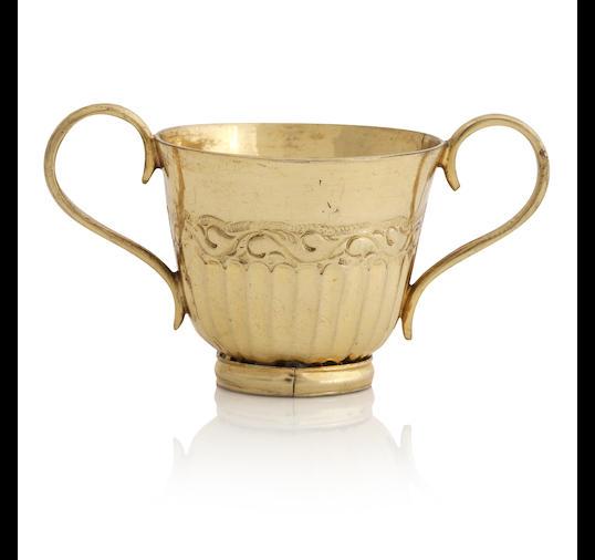 A miniature Irish silver gilt twin handled porringer