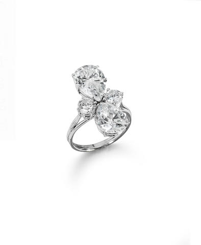 A pear-shaped and brilliant-cut diamond four-stone ring