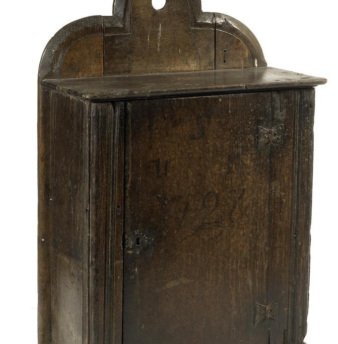 An 18th century oak hanging cupboard