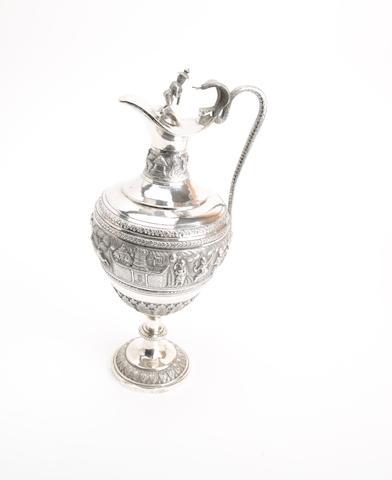 An Indian metal claret jug