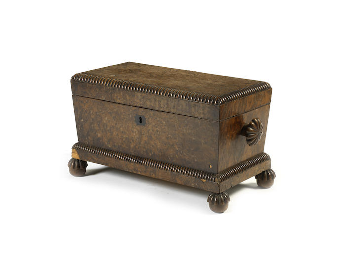 A late 18th / early 19th century mahogany table top bureau together with a William IV burr yew tea caddy