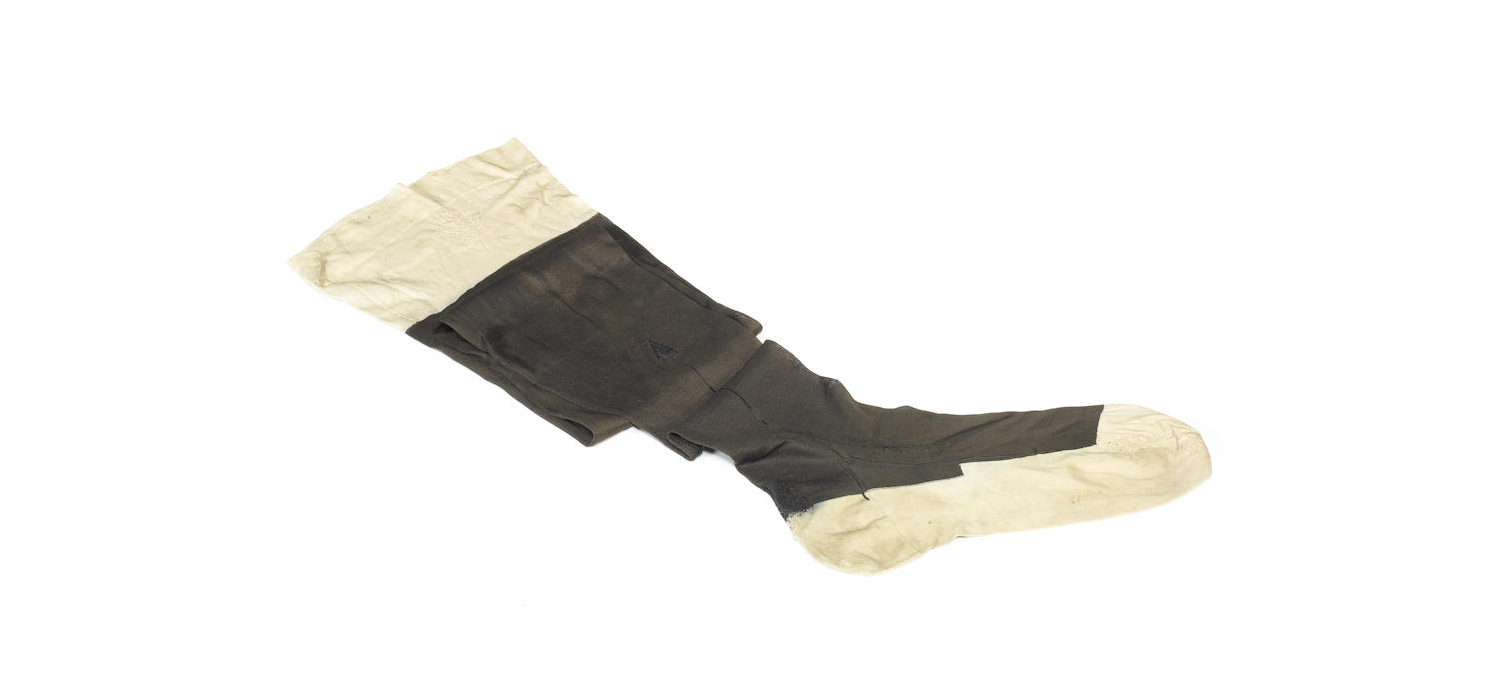 A late 19th century black silk stocking belonging to Queen Victoria