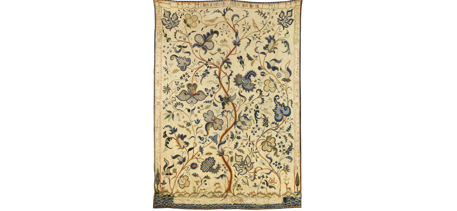 An early 20th century crewel work bedspread
