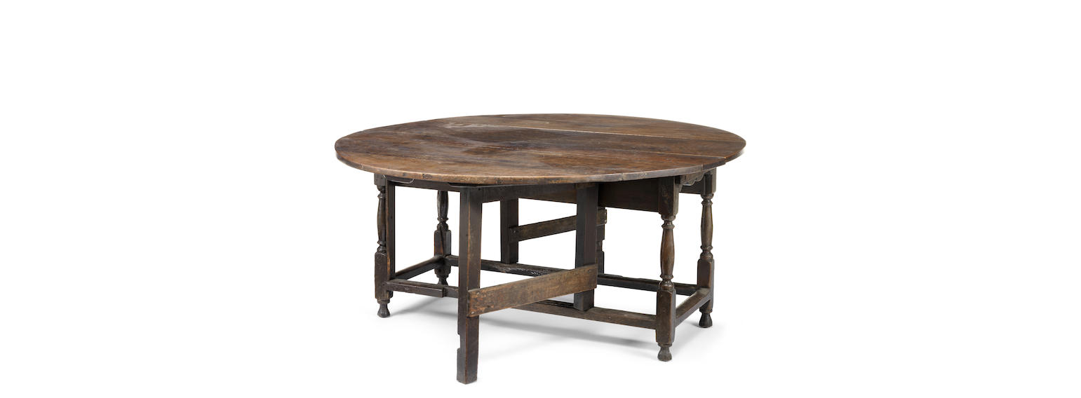 A large early 18th century oak gateleg dining table