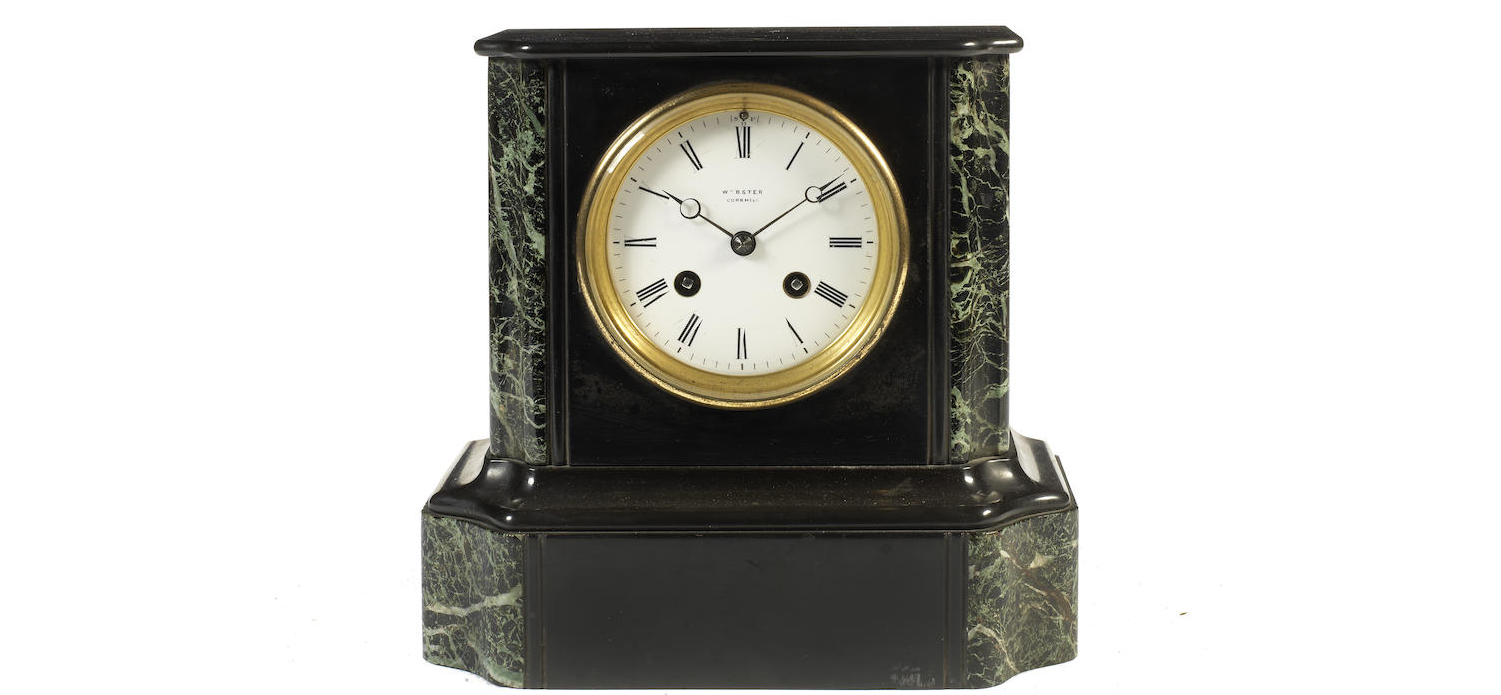 A mid 19th century slate and marble mantle timepiece