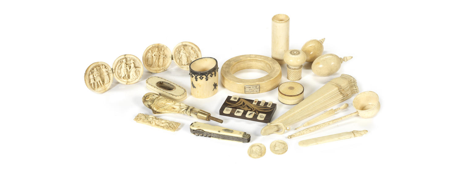 A collection of carved ivory and bone