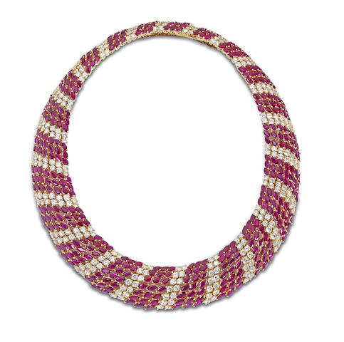 A ruby and diamond necklace, bracelet and earring suite