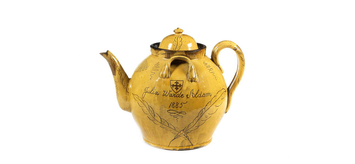 A massive slipware teapot and cover