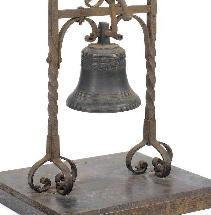 A late 17th century bronze bell on stand