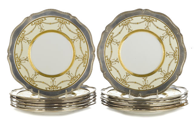A set of twelve Minton porcelain silver mounted service plates with monogram