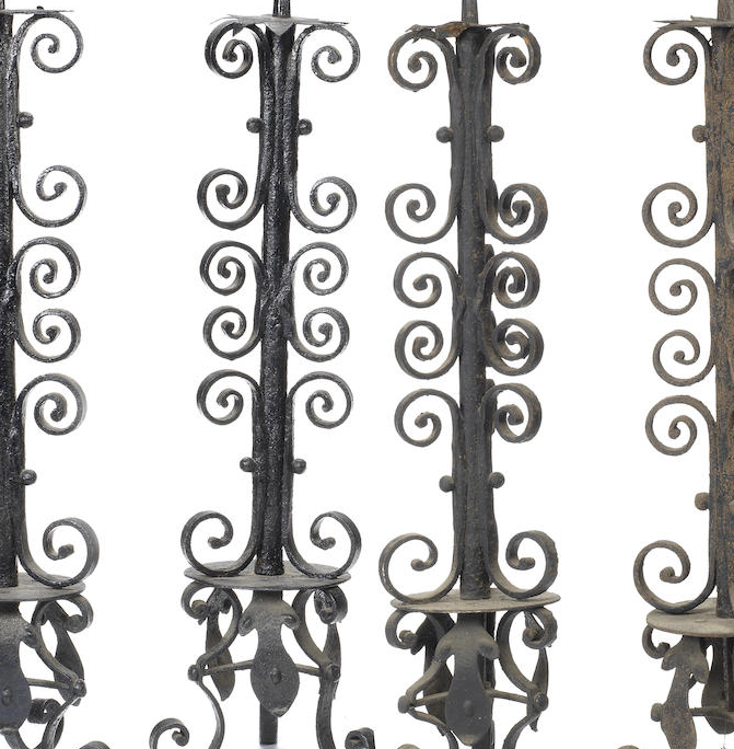 A set of four Victorian painted wrought iron pricket candlesticks
