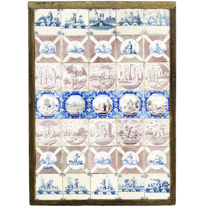 A framed collection of thirty five 18th and 19th century Delft tiles