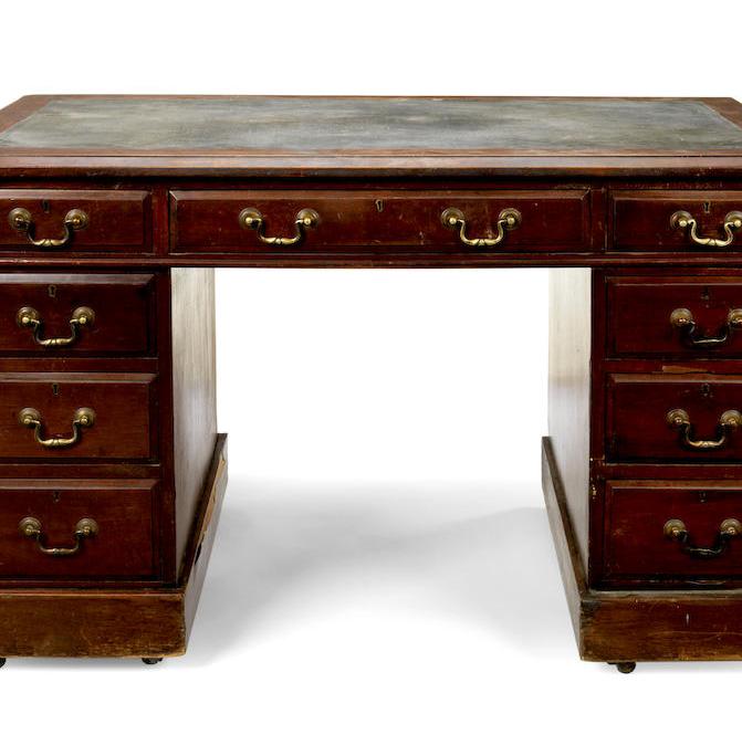 An Edwardian mahogany pedestal desk