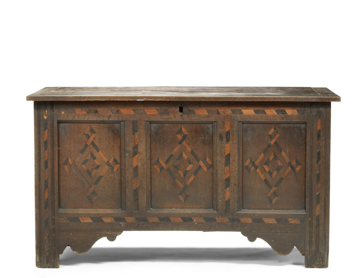 A late 17th/ early 18th century oak and fruitwood inlaid coffer