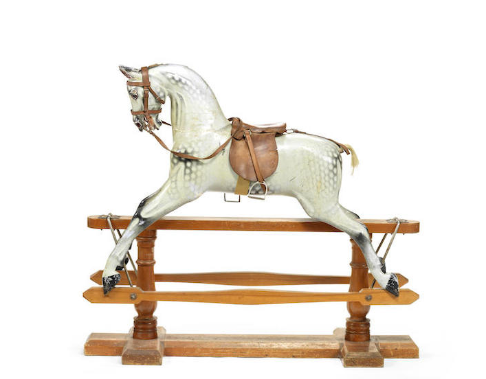 A first half 20th century carved and polychrome decorated rocking horse