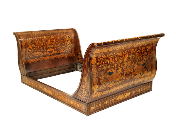 A Dutch early 19th century mahogany and floral marquetry lit en bateau