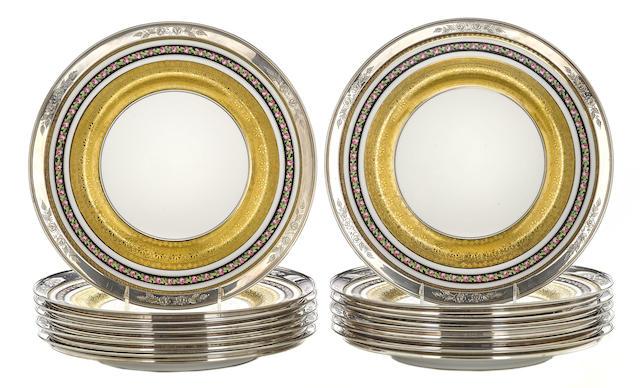 Twelve Shreve & Co. sterling silver mounted bone china service plates