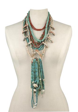 A collection of Pueblo necklaces and Navajo jaclas