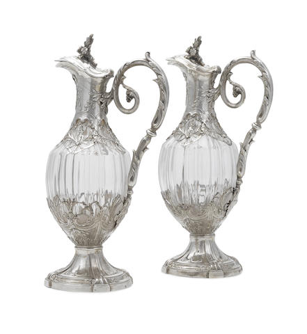 A pair of French first standard silver-mounted clear-glass claret jugs