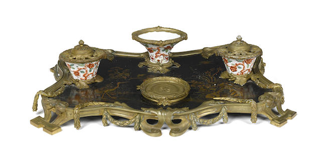 A French porcelain gilt bronze mounted lacquered encrier