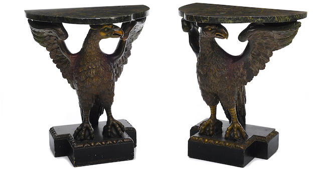 A pair of George II style parcel gilt and paint decorated consoles