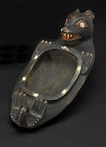 A Northwest Coast otter effigy bowl