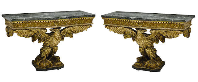A pair of George II style carved giltwood consoles
