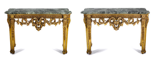 A pair of George II style giltwood consoles