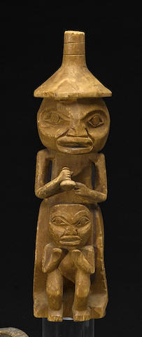 A Northwest Coast figural carving