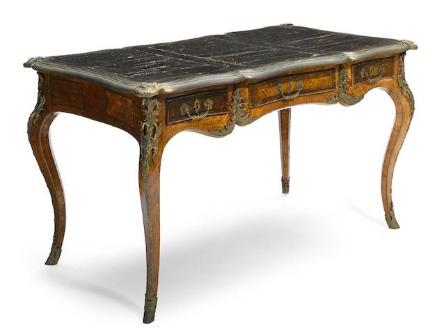 A Louis XV gilt bronze mounted inlaid walnut bureau plat