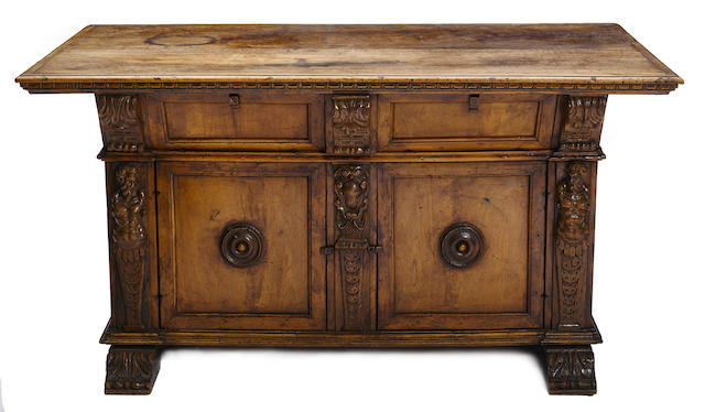 An Italian Baroque carved walnut center table