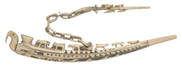 An Eskimo scrimshaw walrus ivory pipe