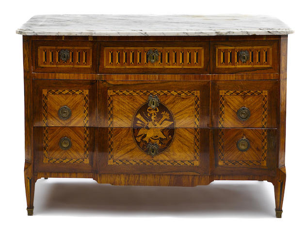 A Louis XVI marquetry inlaid kingwood commode