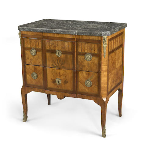 A Louis XV/XVI Transitional gilt bronze mounted marquetry inlaid walnut commode