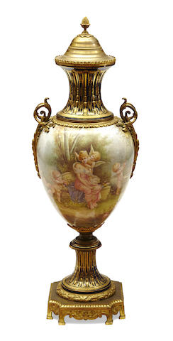 An imposing Sèvres style earthenware gilt bronze mounted covered urn
