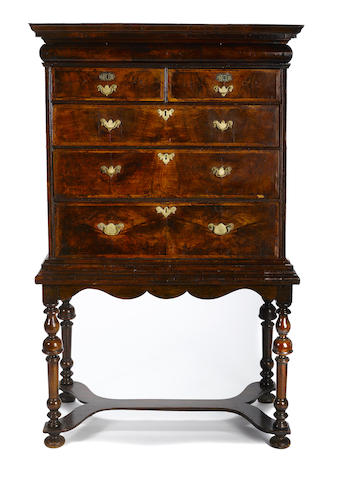 A William and Mary inlaid walnut chest on stand