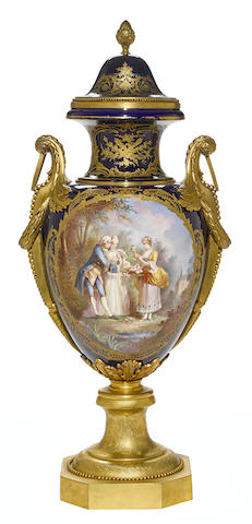 A Sèvres style earthenware gilt bronze mounted covered urn