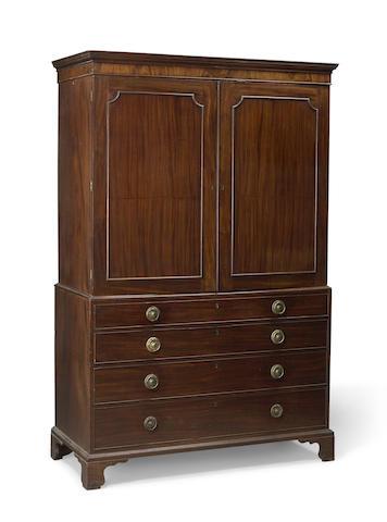 A George III mahogany secretary linen press possibly Gillows